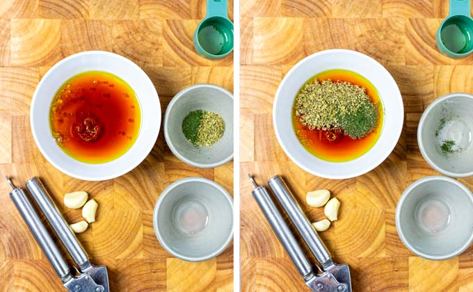 Making the salad dressing: mix of red vinegar with herbs.