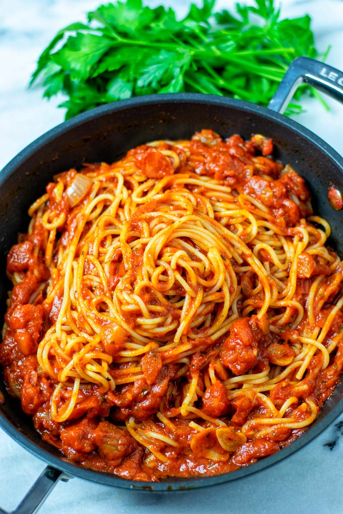 View on a sauce pan with Spaghetti Sauce mixed with cooked pasta.