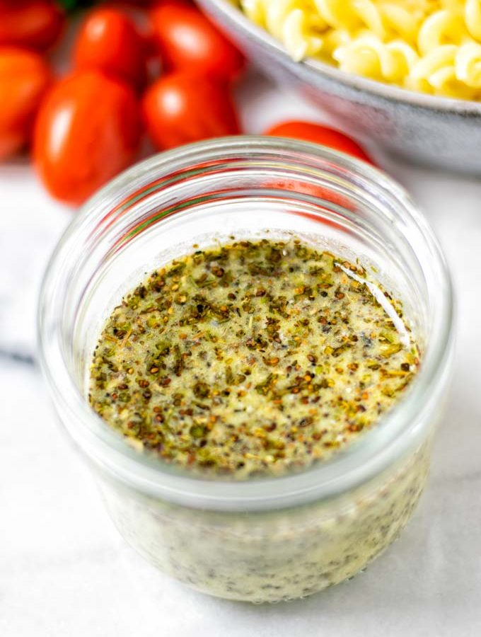 Closeup on the Italian Dressing in a glass jar.