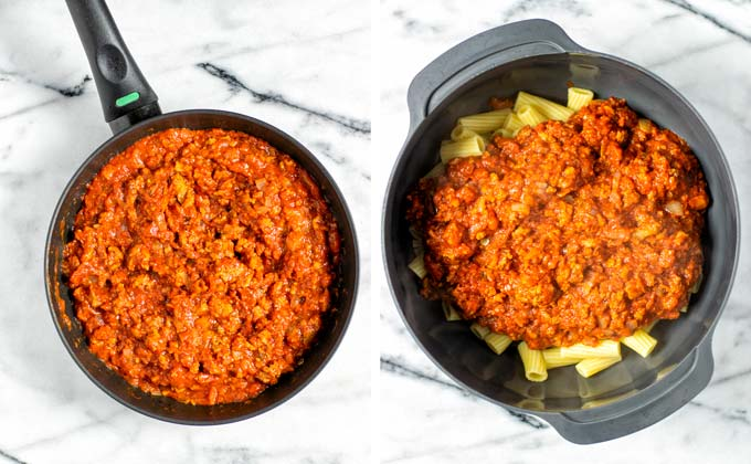The tomato beef sauce is mixed with precooked pasta in a large bowl.
