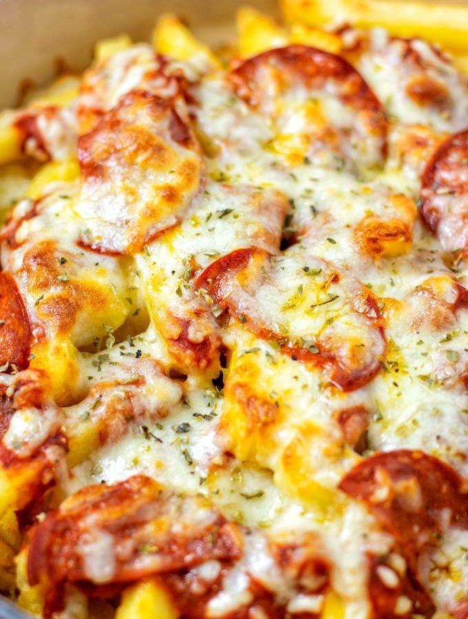 Closeup on the Pizza Fries in a casserole dish.
