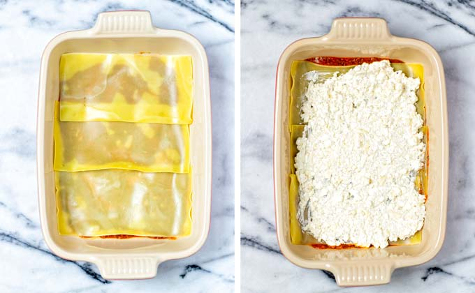 Lasagna noodles are placed on the marinara sauce in the casserole dish, followed by the cottage cheese mix.
