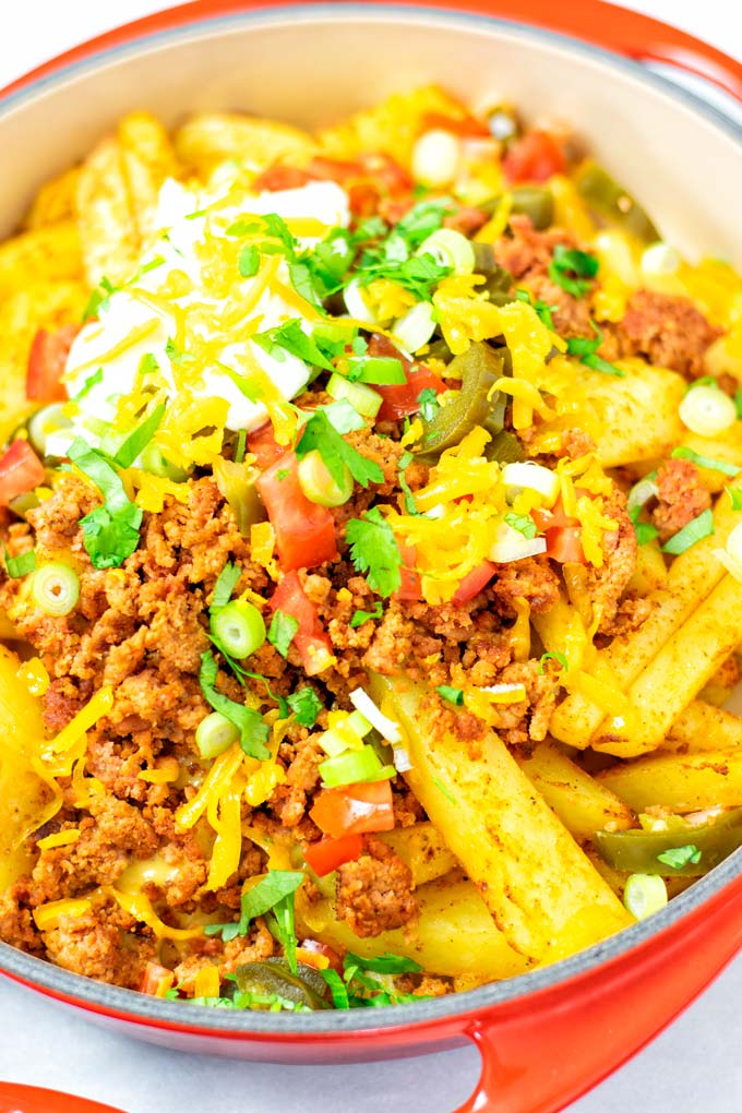 Closeup of the ready Nacho Fries in a large dish.