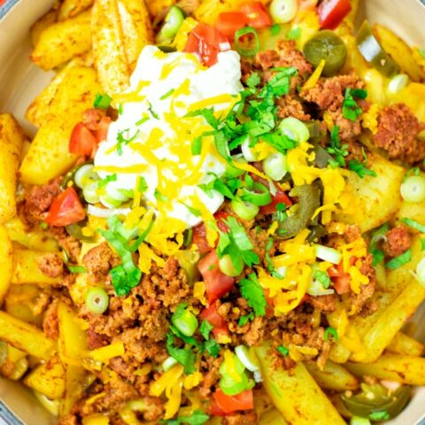 Top view on the Nacho Fries in a large casserole dish.