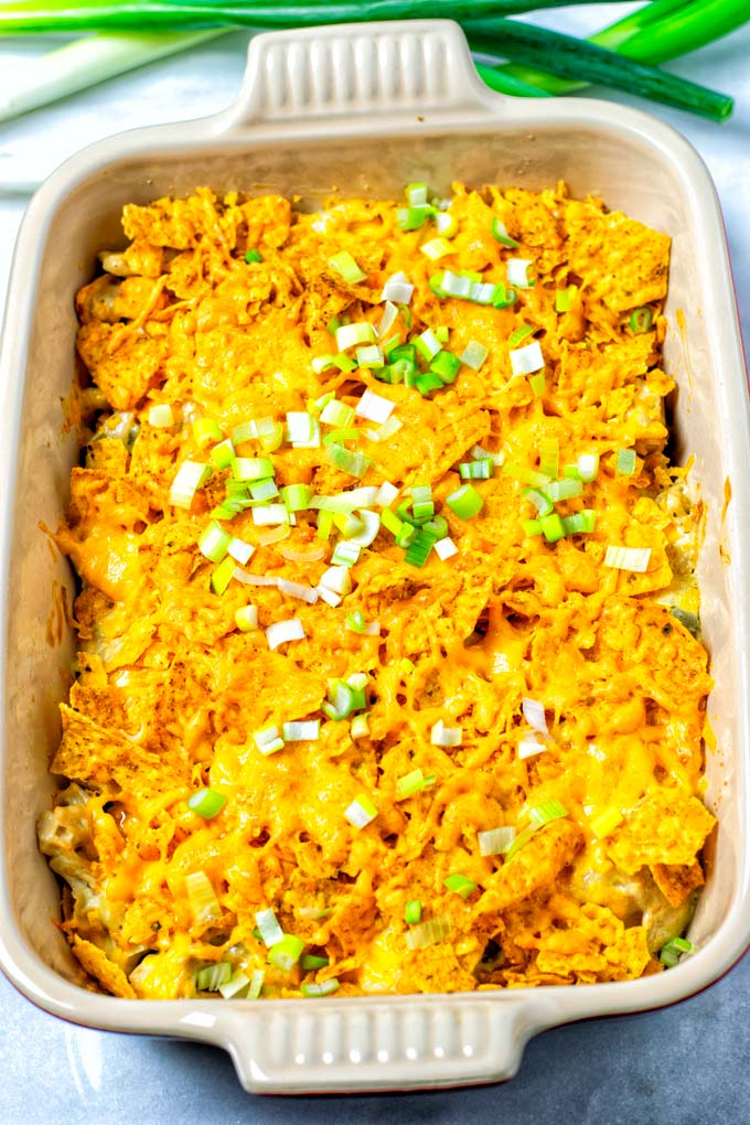 The baked Dorito Casserole is shown with some green onion on top.