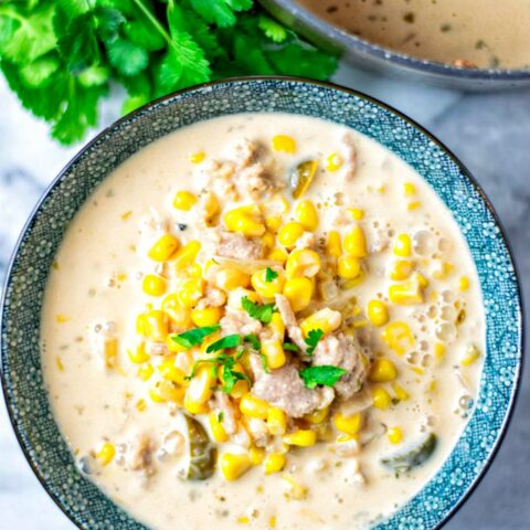 Pot view on a portion of the Corn Soup showing clearly the corn, vegan ground beef, jalapeno slices and creamy liquid.