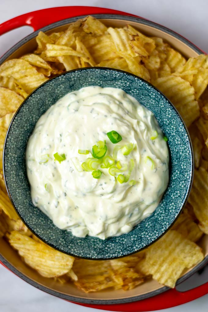 Top view on a bowl with the Potato Chip Dip with fresh scallions.