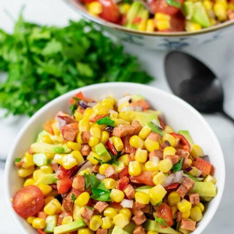 Portion bowl of the Corn Salad with the larger bowl in the background.