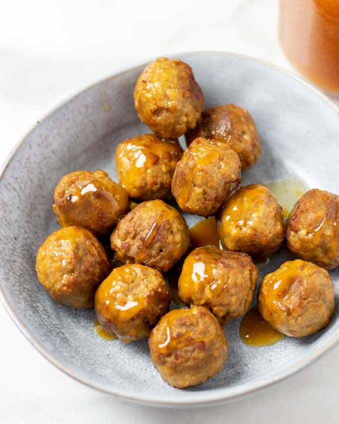 A portion of vegan meatballs covered in Hawaiian Sauce.