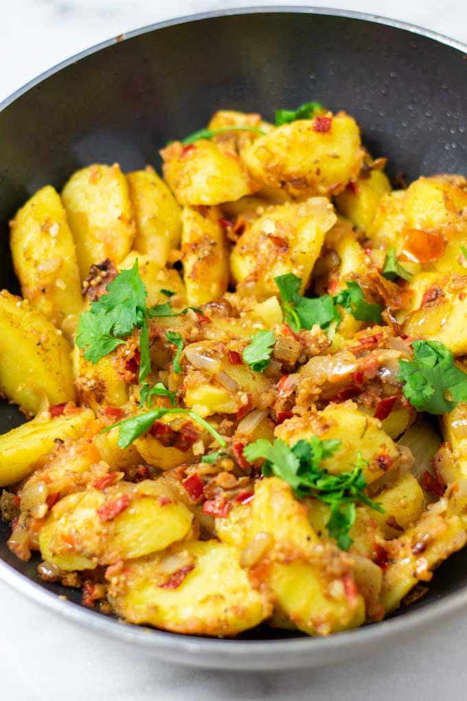 Bombay Potatoes in a big pan.