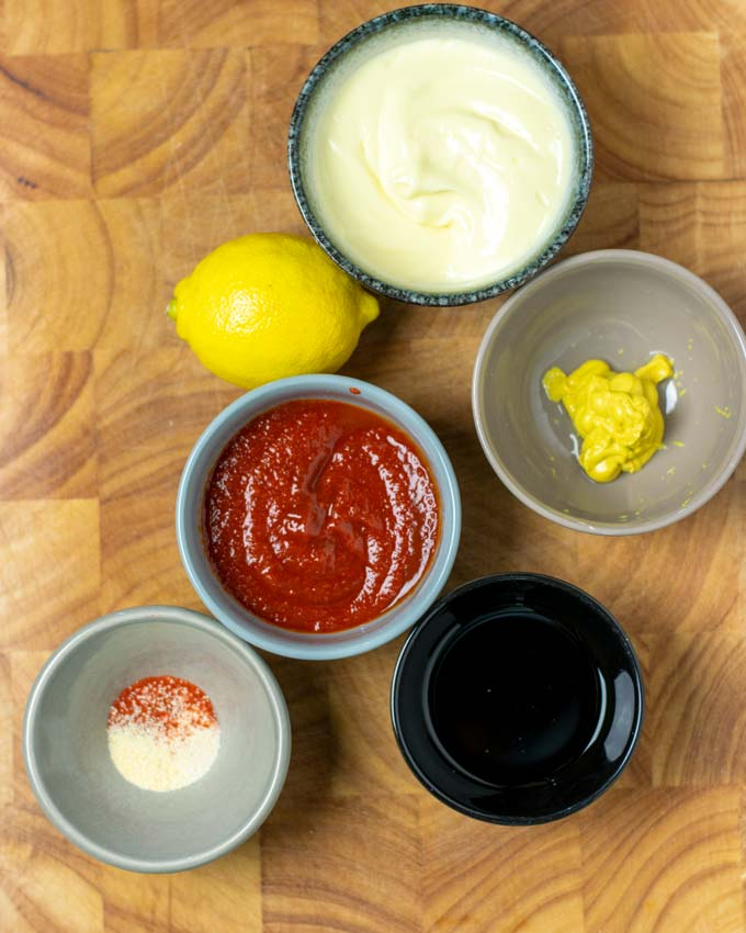 Ingredients for the Comeback Sauce assembled on a wooden board.