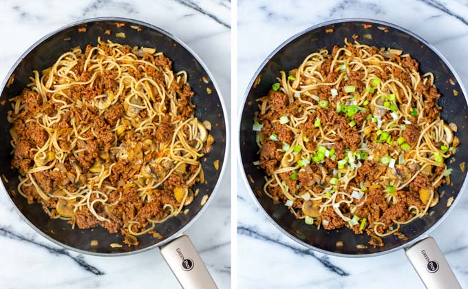 Side by side view of the Mushroom Noodles in a large pan with fresh scallions on top.