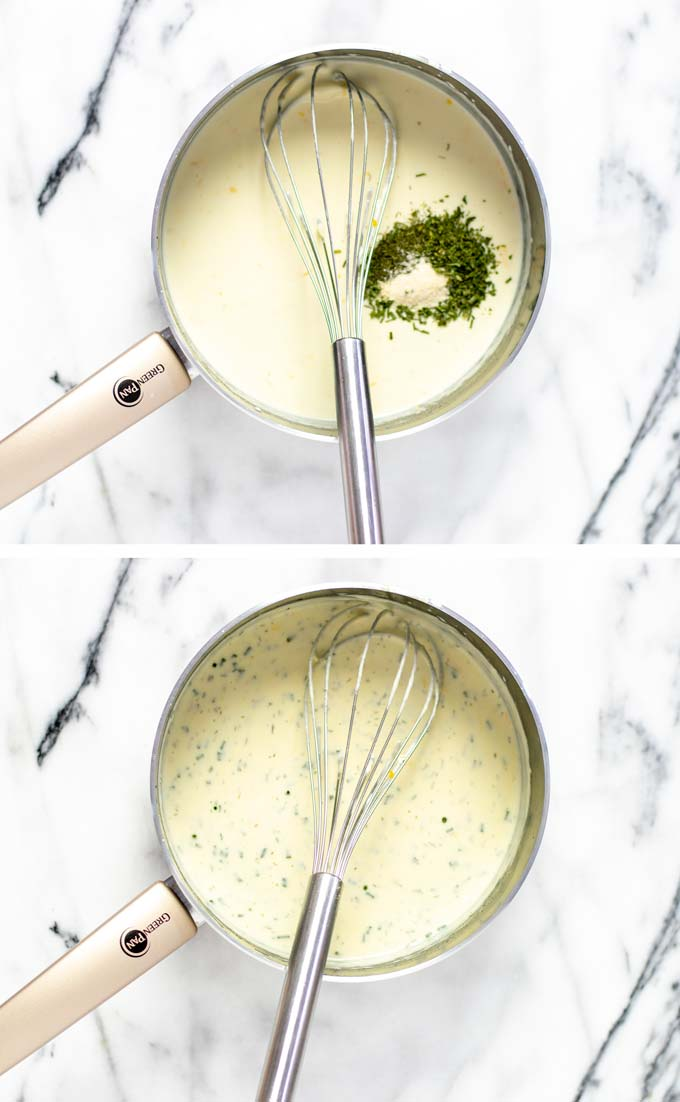 The creamy white sauce is mixed with herbs and spices.