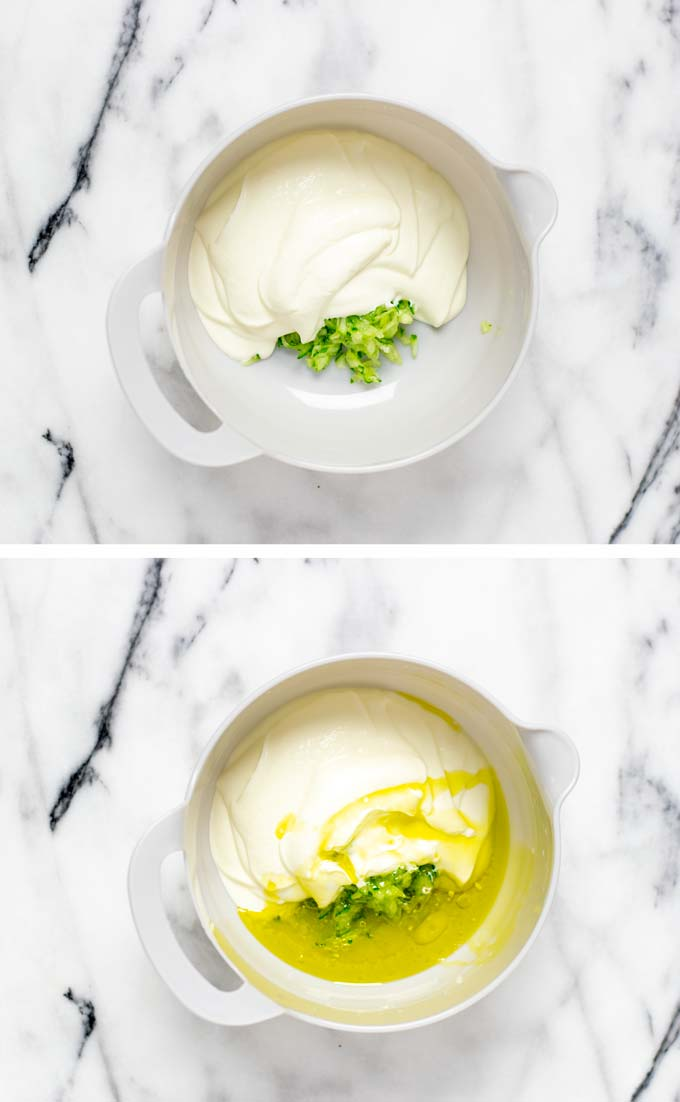 Grated cucumbers are mixed with Greek yoghurt and olive oil in a large mixing bowl.