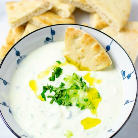 Bowl of the Tzatziki Sauce with toasted pita bread.