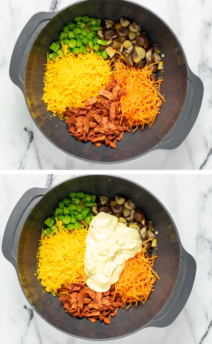 Salad ingredients are mixed in a large mixing bowl with vegan mayo.