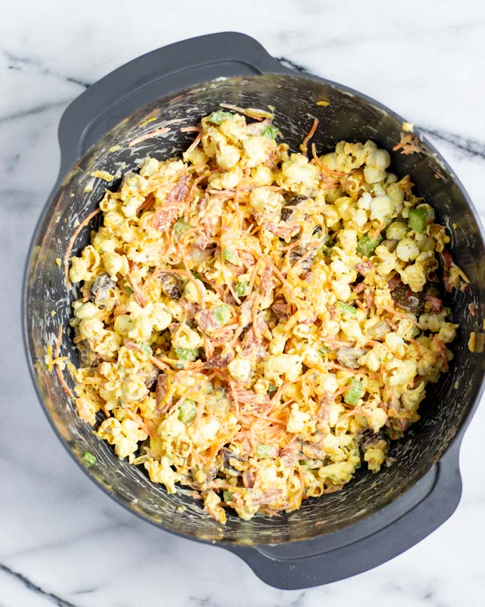 View of the ready mixed Popcorn Salad in a large mixing bowl.