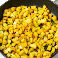 Country Potatoes are garnished with fresh chives.